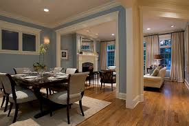 Comfortable Dining Room Design Idea With White Fabric Chairs Wooden Legs And Round Recessed