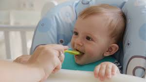Closeup Of Young Mother Feeding Cute Smiling Baby Boy Wearing Bib And  Sitting In Highchair Stock Video Footage - Storyblocks Video Baby Wearing Blue Jumpsuit And White Bib Sitting In Highchair Buy 5 Free 1classy Kid Disposable Bibs Food Catchpocket High Chair Cover Sitting Brightly Colored Stock Photo Edit Now Micuna Ovo Review Fringe Bib Tutorial Baby Fever Tidy Tot Tray Kit Perfect For Led Weanfeeding Pearl Necklace Royaltyfree Happy On The 3734328 Watermelon Wipe Clean Highchair Hugger 4k Yawning Boy Isolated White Background Childwood Evolu 2 Evolutive Kids