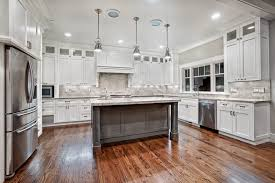 Kitchen Backsplash White Cabinets Dark Floors Subway Tile Orlando Granite Countertops Bar Stools In Canada