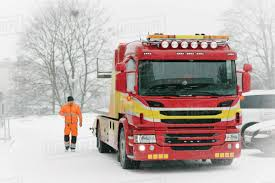 100 Free Tow Truck Service Driver Walking By Tow Truck During Winter Stock Photo Dissolve