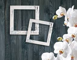 White Magnolia Flowers And Photo Frame On Background Of Shabby