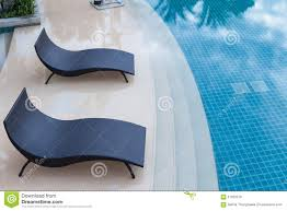 Download Beach Chairs Near Swimming Pool Top View Stock Photo