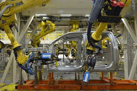 Is That A Robot In The Driver's Seat At Ford's F-150 Plant ... Michigan Supplier Fire Idles 4000 At Ford Truck Plant In Dearborn Tops Resurgent Us Car Industry 2013 Sales Results Show The Could Reopen Two Plants Next Friday F150 Chassis Go Through Assembly Fords Video Inside Resigned To See How The 2015 F Announces Plan To Cut Production Save Costs Photos And Ripping Up History Truck Doors For Allnew Await Takes Costly Gamble On Launch Of Its Pickup Toledo Blade Plant Vision Sustainable Manufacturing Restarts Production