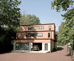100 Storage Containers For The Home Facade And Garage Entrance Of Shipping Container Home In
