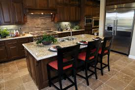 Large Marble Topped Island With Dining Space Centers This Kitchen Over Beige Tile Flooring