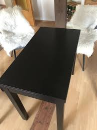 2 esszimmerstühle ikea plus kissen und tisch holz schwarz