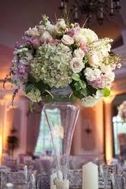 Wedding Reception Centerpiece Of White Green Pink And Light Purple Flowers In A