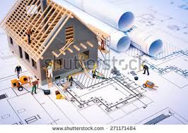 House Building by Building House On Blueprints Worker Construction Stock Photo
