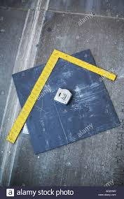 measuring square and tile on subfloor stock photo royalty