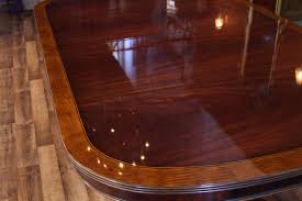 Close Up Details Of Mahogany Dining Table With Satinwood Banding