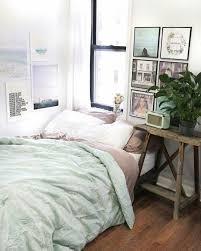 mint green bedding a mix of mid century modern bohemian