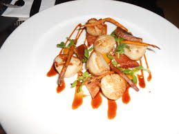 A Plate Of Scallops With Bacon In Bar At Chiswell Street Dining Rooms