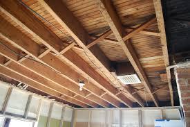 Exposed Basement Ceiling Lighting Ideas by Insulating Basement Ceiling Joists Bjhryz Com
