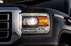 gmc headlight lawsuit says headlights are dim