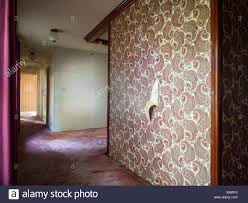 100 Decorated Wall Empty Room With Decorated Walls With Wall Paperinside A Foreclosed