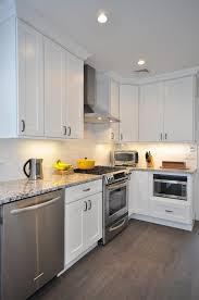 Pinterest Kitchen Soffit Ideas by Staggered White Shaker Kitchen Cabinets Aspen 2520white
