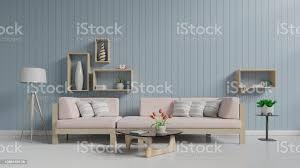 wohnzimmer mit sofa sessel le regal blau boden weiß und wand stockfoto und mehr bilder architektur
