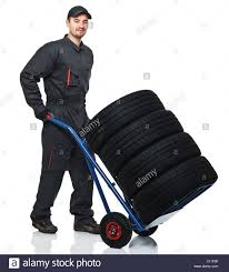 Caucasian Tire Repairer With Handtruck Isolated On White Stock Photo ... Flatfree Hand Truck Tires Dolly Wheels Northern Tool Equipment Farm Ranch 13 In Pneumatic Tire 4packfr1035 The Home Depot Amazoncom Marathon 2802504 Flat Free Utility Top 5 Best Convertible Trucks 2018 Reviews And 2pk 10 Noflat 207549 Carts Dollies At Inch Wheel Assembly Cafree Universal 00210 Do It Best Wheelbarrow Roofing 4 Set Steel Air Wagon Ebay Replacement Parts
