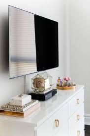 chic bedroom features a flatscreen tv atop a white ikea malm