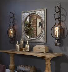 amazing large wall sconces contains a mirror and lights above the