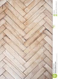 Top View On Rich Texture Of Vintage And Distressed Wooden Parquet Floor Pattern Made From Many Racks In Herringbone Shape Vertical Image