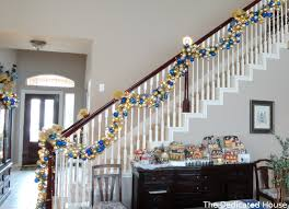 Banister Decked Out For Christmas At The Dedicated House - The ... Home Depot Bannister How To Hang Garland On Your Banister Summer Christmas Deck The Halls With Beautiful West Cobb Magazine 12 Creative Decorating Ideas Banisters Bank Account Season Decorate For Stunning The Staircase 45 Of Creating Custom Youtube For Cbid Home Decor And Design Christmas Garlands Diy Village Singular Photos Baby Nursery Inspiring Stockings Were Hung Part Adams
