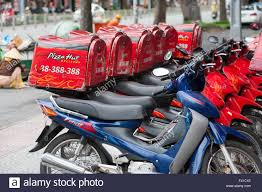 Pizza Hut Delivery Motorcycles In Saigon