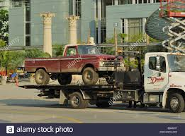 Large Truck Removing A Ford Pickup Truck From The Percy Jackson, The ...