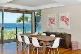 Inspiration For A Contemporary Medium Tone Wood Floor Dining Room Remodel In Brisbane With Beige Walls