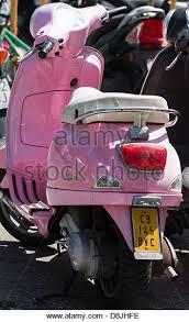 Parked Pink Vespa Scooters Cadiz