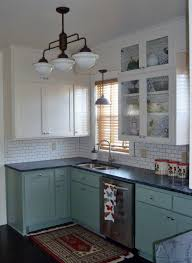 warehouse shades schoolhouse lights feature in kitchen remodel