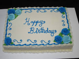 Classic sheet cake with blue buttercream roses for a special