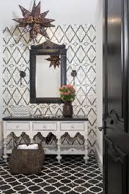 moroccan style powder room with black marble quatrefoil tiles