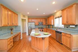 traditional kitchen with glass panel hardwood floors in