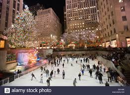 Rockefeller Plaza Christmas Tree by Ice Skaters At Ice Skating Rink At The Christmas Tree At