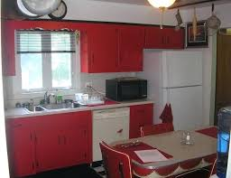 50s Kitchen Retro Decor With Red Wooden Cabinet And White Refrigerator Also Small Window