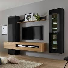 moderne wohnwand ohne beleuchtung in hochglanz schwarz mit eiche hell