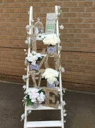 White Ladder Of Love With Rustic Letters And Jars Cream Flowers For Hire Perfect Wedding Idea Scene Setters Venue Decorations Check Us