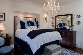 Antique Gold Crystal Chandelier For Narrow Bedroom Decor With Fancy Queen Headboard And Dark Brown Vanity Drawers