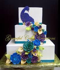 Elegant Peacock Wedding Cake with Sugar Paste Roses