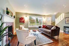 Brown Couch Living Room Design by Refreshing Living Room With Light Green Walls Hardwood Floor
