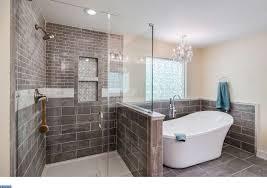 contemporary master bathroom with high ceiling slate tile floors