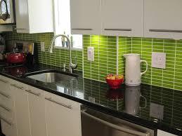 wood white shaker cabinet with black ceramic subway tile
