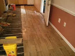 wood look plank tile installation time lapse on schluter ditra