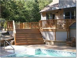 cedar rail deck custom deck adjacent pool with cedar rails and