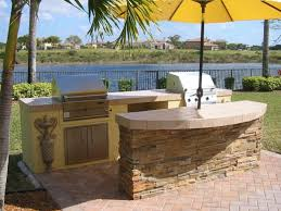 Stupendous Outdoor Kitchen Gas Grills With Half Round Breakfast Bar And Spanish Wall Decor