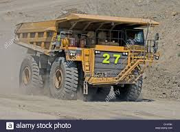 Huge Mining Dump Truck Being Driven Along Dusty Road At Open Cut ... Heavy Excavator Loading Granite Rock Or Iron Ore Into The Huge Watch This Giant Dump Truck Fart Out An Actual Fireball Mine Worker Truck Driver Dwarfed By Huge Ming Dump In American Plastic Toys Gigantic Walmartcom Big Stock Photo Image Of Outdoors Black 62349404 Man Front Wheel Uranium Mine Wheel Loader Sizzlin Cool Beach Color And Styles May Vary At Ok Tedi Gold Papua New Guinea Stock Photo Xxl Rc Cstruction Site Big Scale Model Dump Trucks And Excavator Just A Picture Huge I Mean Just Look It 4k 450 Tone Video Footage Videoblocks