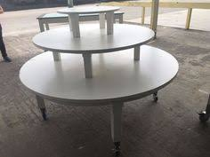 Former American Eagle Display White Wood 3 Tier Retail Tables W Wheels