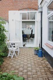 interlocking deck tiles in patio scandinavian with patio door