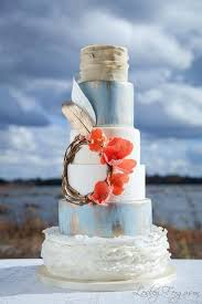 Rustic Baby Blue And White Wedding Cake With Silvery Gold Feathers Coral Flowers
